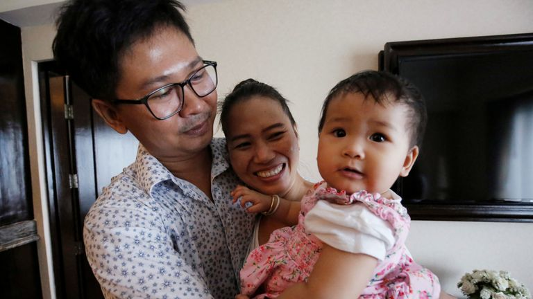 Reuters reporter Wa Lone and his wife Pan Ei Mon celebrate with their daughter