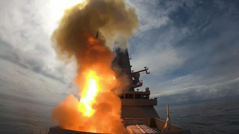 In a burst of fire and smoke, Royal Navy warship HMS Defender has tested her world-beating missile system off the Scottish coast