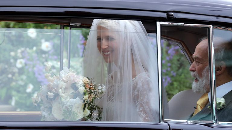 Lady Gabriella Windsor smiles as she arrives for the ceremony