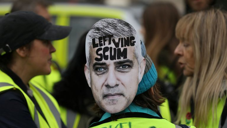 A protester wears a mask of the London mayor at a pro-Brexit demonstration in the capital