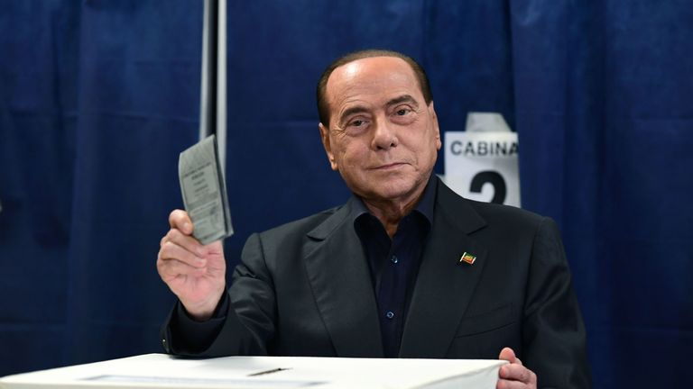 Silvio Berlusconi casts his vote at a polling station in Milan
