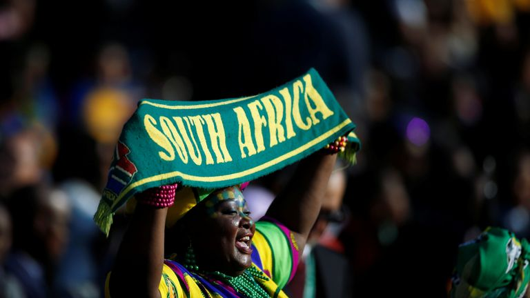 Supporters sing as they arrive for the inauguration of Cyril Ramaphosa