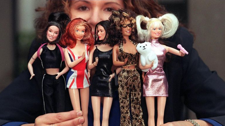 A young girl holds the Spice Girls dolls which were unveiled at the Toy Retailers Fair in London by the Character Group which has exclusive rights to distribute the dolls in the UK 16 October