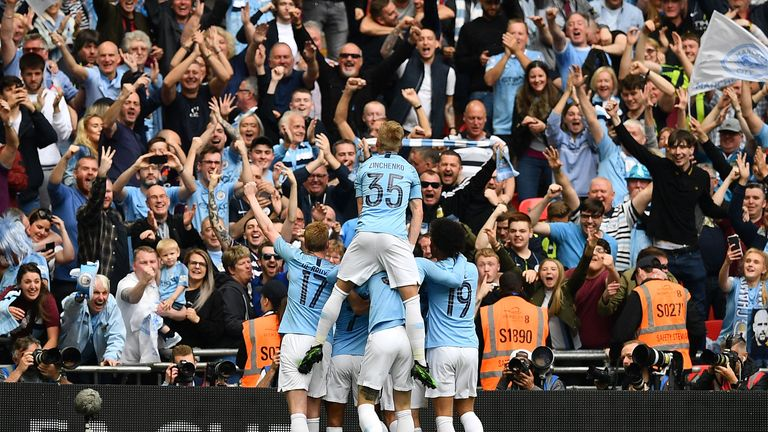 Raheem Sterling celebrates with teammates after the fifth goal