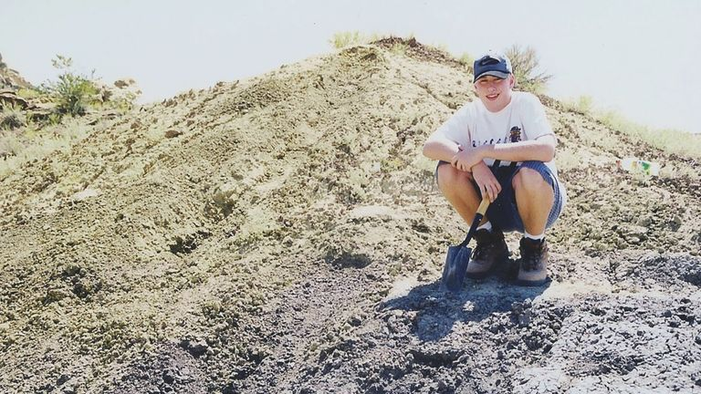 Sterling Nesbitt at age 16 in western New Mexico, where he found the fossil remains of what would be named Suskityrannus hazelae. Photo by Hazel Wolfe.