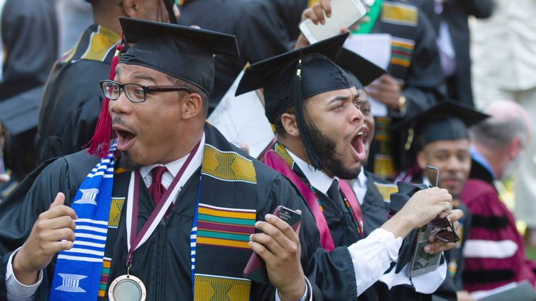 Students celebrate as Billionaire Robert F. Smith announces he will provide grants to wipe out the student debt of the entire 2019 graduating class at Morehouse College in Atlanta