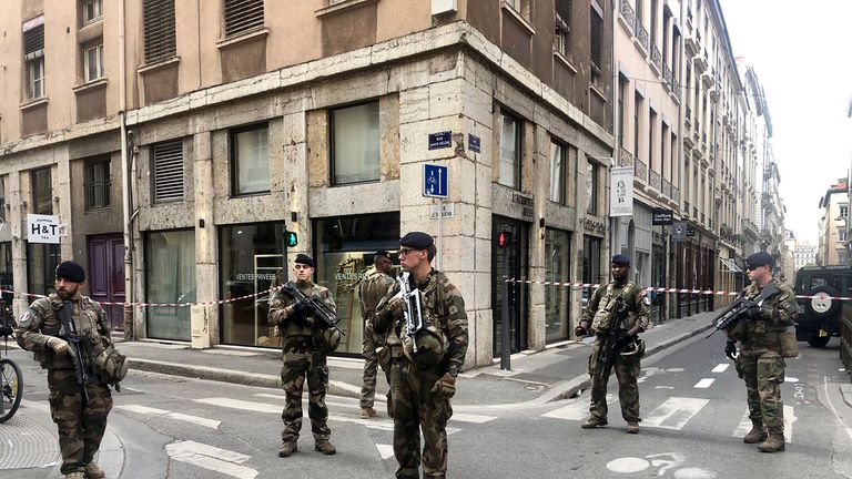 "Soldiers of French anti-terrorist plan ""Vigipirate Mission"", secure the access near the site of a suspected bomb attack in central Lyon"