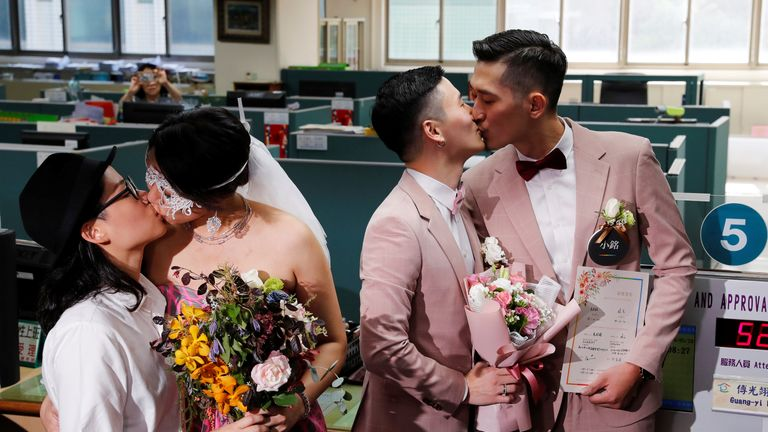 Couples Shane Lin (R) and Marc Yuan, and Cynical Chick (L) and Li Ying-Chien, kiss after registering for same-sex marriage at the Household Registration Office in Shinyi District in Taipei, Taiwan May 24, 2019. REUTERS/Tyrone Siu