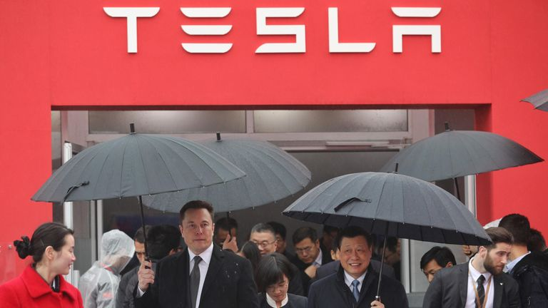 "Tesla boss Elon Musk (L) walks with Shanghai Mayor Ying Yong during the ground-breaking ceremony for a Tesla factory in Shanghai on January 7, 2019. - Musk presided over the ground-breaking for a Shanghai factory that will allow the electric-car manufacturer to dodge the China-US tariff crossfire and sell directly to the world's biggest market for ""green"" vehicles. (Photo by STR / AFP) / China OUT (Photo credit should read STR/AFP/Getty Images)"
