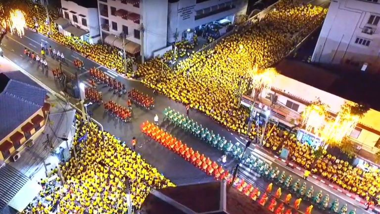 This screengrab from Thai TV Pool video taken on May 5, 2019 shows an aerial view of crowds watching the coronation procession of Thailand's King Maha Vajiralongkorn in Bangkok. (Photo by Thai TV Pool / THAI TV POOL / AFP) (Photo credit should read THAI TV POOL/AFP/Getty Images)