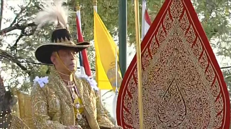 The King of Thailand is paraded through the streets as part of his coronation