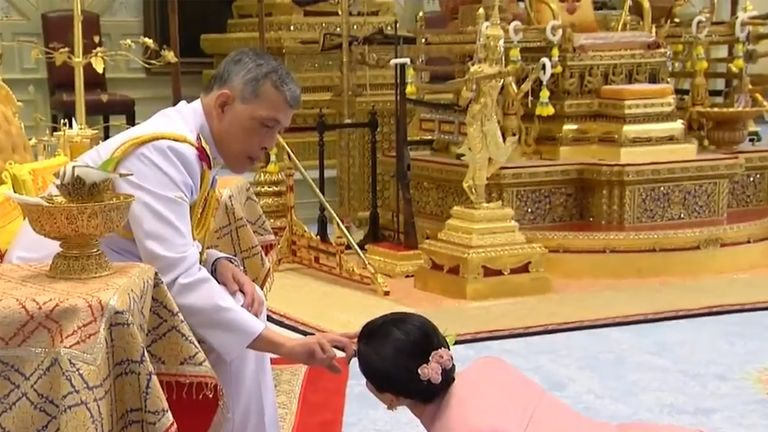 Thai television showed a video of Suthida prostrating herself before the king