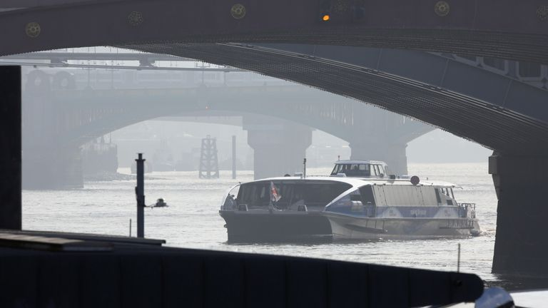 A boat makes it's way across the Thames