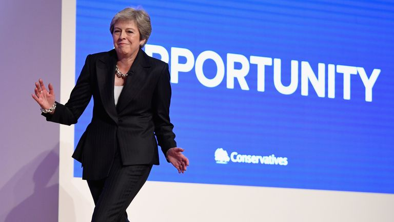 Theresa May dances her way on stage