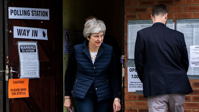 Prime Minister Theresa May and her husband Philip leave after casting their votes at a polling station in the local council elections on May 2, 2019 in Sonning, England