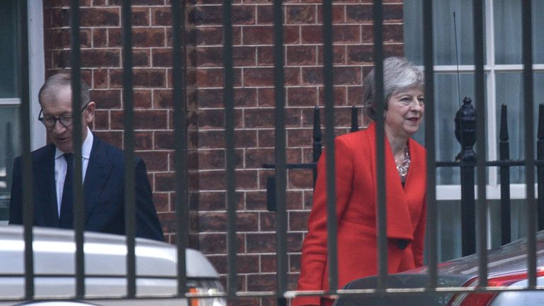 Theresa May and husband Philip after the statement at Downing Street