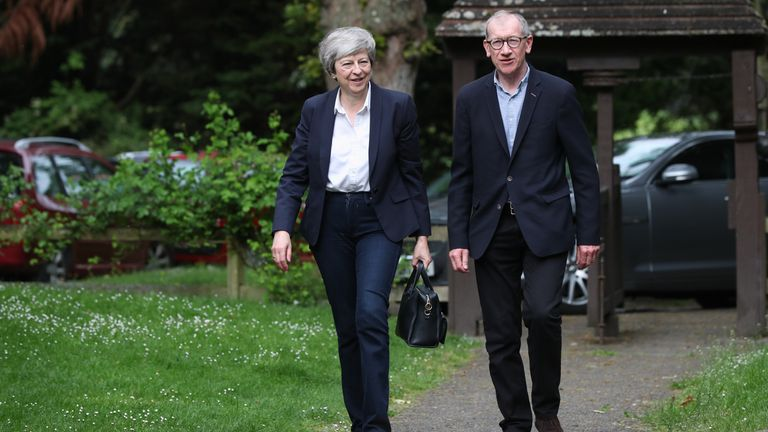 Theresa May arrives with her husband Philip attend a church service near her Maidenhead constituency