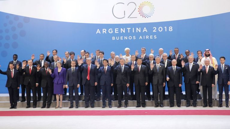 Mrs May, fourth from left on the front row, and Mr Putin, fourth from right on the front row, spoke on the sidelines of the G20 summit in Argentina in 2018
