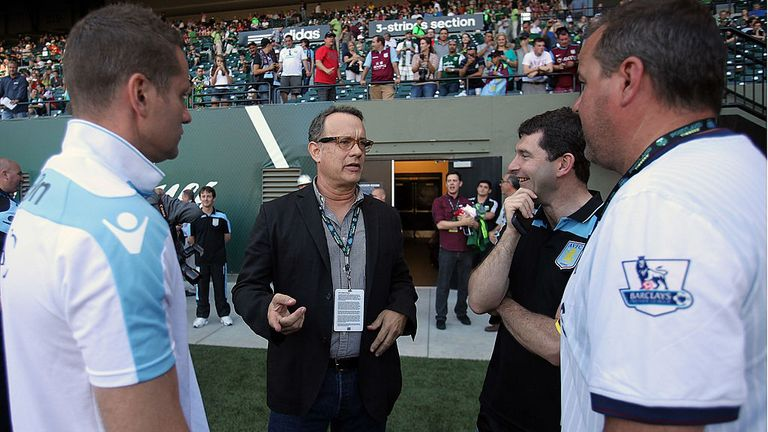 PORTLAND, OR - JULY 24:  Actor Tom Hanks chats with members of Aston Villa obefore the game against the Portland Timbers at Jeld-Wen Field on July 24, 2011  in Portland, Oregon.  (Photo by Jonathan Ferrey/Getty Images)