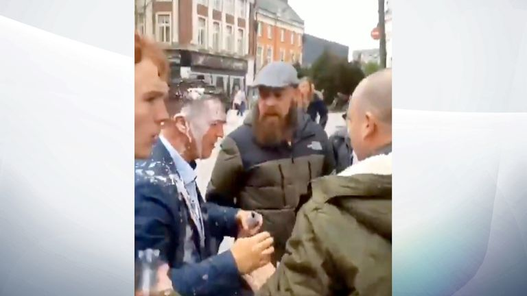 The far right activist was seen with milkshake on his head and suit. Pic: @SianyJx