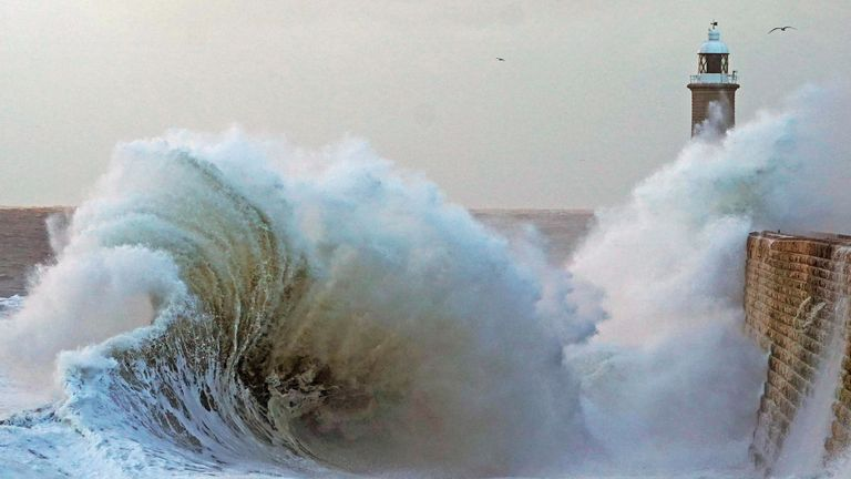 Waves crash over the sea wall at Tynemouth in the north east of England. The UK is expected to be hit with cold showers, frost and strong winds across the bank holiday weekend just weeks after record-high temperatures at Easter.