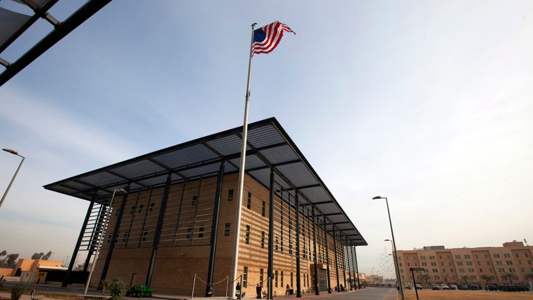 A U.S. flag flies in front of the Annex I building inside the compound of the U.S. embassy in Baghdad..