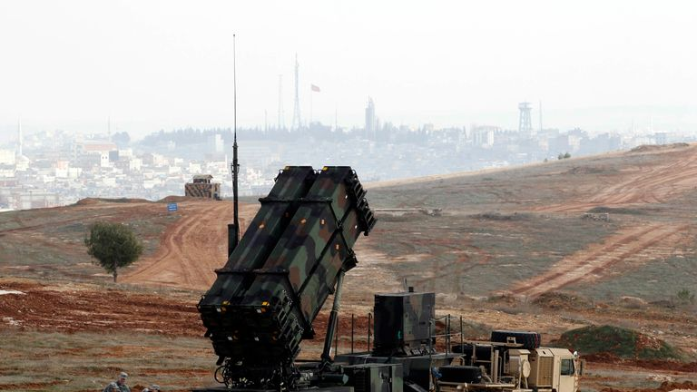 US soldiers wait beside a US Patriot missile system at a Turkish military base