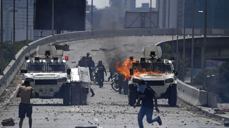 Protesters clashed with security forces in Venezuela on Tuesday