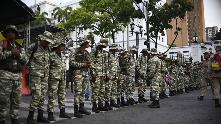 Militias supporters of President Maduro make a parade in front of the Presidential Palace of Miraflores