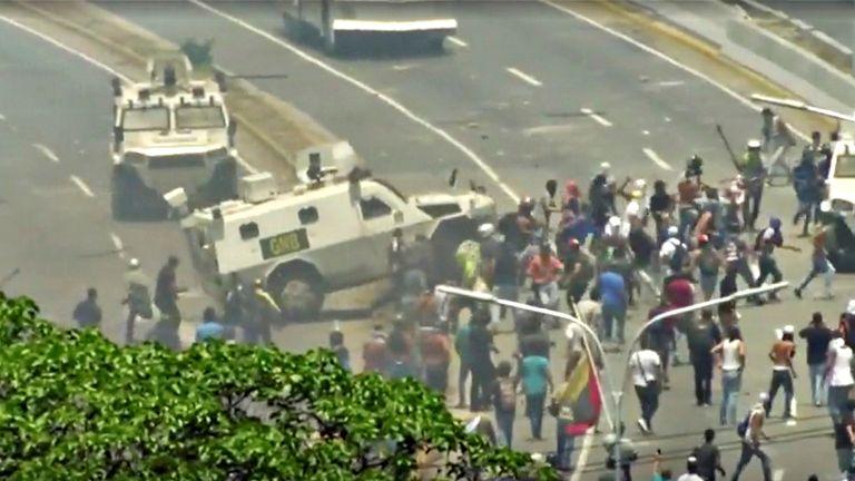 A Venezuelan National Guard (GNB) vehicle ploughs into opposition demonstrators in Caracas