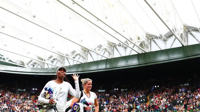 Venus Williams and Kim Clijsters walk off court after their match