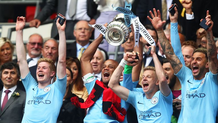 Kompany lifts the trophy after City won the FA Cup Final
