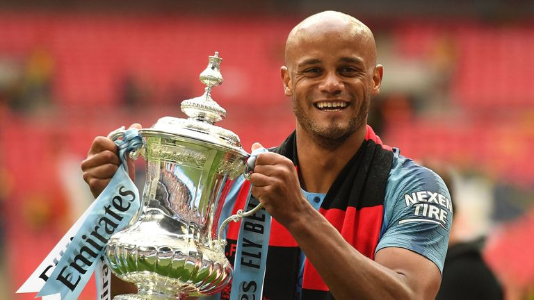 Vincent Kompany holds the winner's trophy after the English FA Cup final