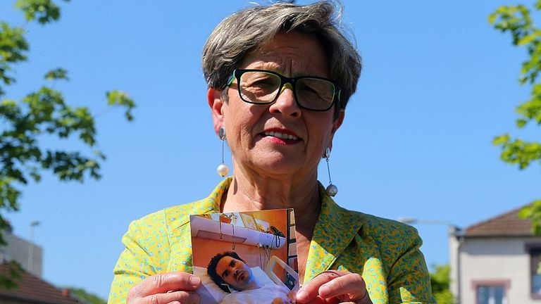 Viviane Lambert, the mother of Vincent Lambert, a quadriplegic man on artificial life support, poses with a photo of her son in Reims, northeastern France, on June 4, 2015. The European Court of Human Rights is due to rule on June 5, 2015 whether to keep Lambert, suffers from irreversible brain damage and is in a chronic vegetative state since a road accident in 2008, on life support.