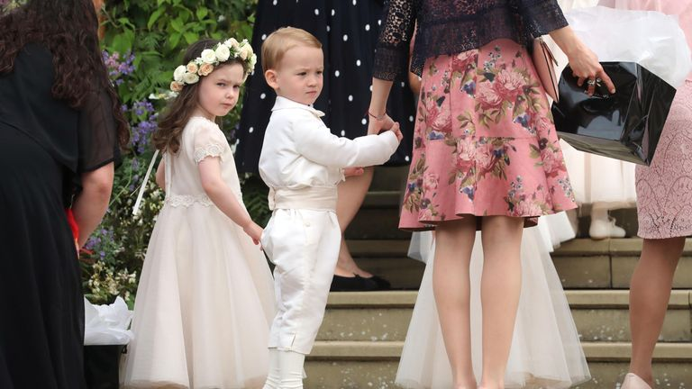 A young page boy and a young bridesmaid walk up the chapel steps for the wedding of Lady Gabriella Windsor