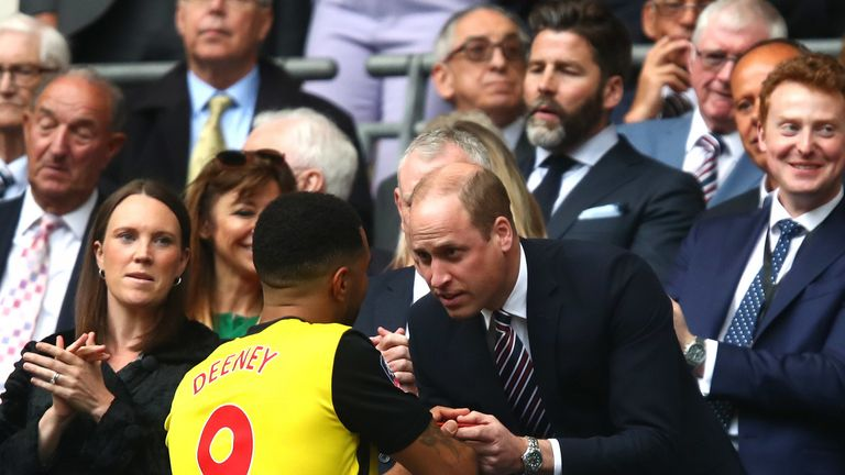 Prince William, Duke of Cambridge talks to Troy Deeney of Watford after their loss