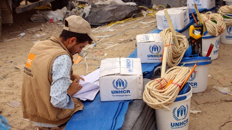 Yemenis displaced from areas near the border with Saudi Arabia receive humanitarian aid