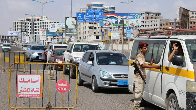A checkpoint manned by a rebel in Yemen