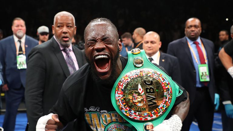 Deontay Wilder celebrates after successfully defending his title for the ninth time