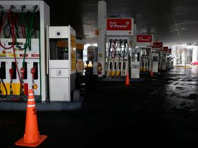 View of a closed gas station in downtown Buenos Aires on June 16, 2019 during a power cut. - A massive outage blacked out Argentina and Uruguay Sunday, leaving both South American countries without electricity, power companies said. (Photo by ALEJANDRO PAGNI / AFP)        (Photo credit should read ALEJANDRO PAGNI/AFP/Getty Images)