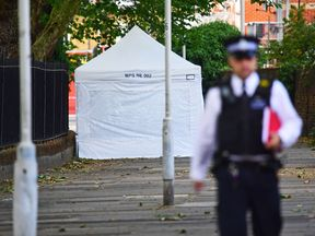 A police forensic tent at the scene in Stratford, east London