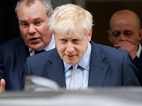 "Conservative MP Boris Johnson (C) leaves after launching his his Conservative Party leadership campaign in London on June 12, 2019. - Boris Johnson launched his campaign Wednesday to replace Theresa May as Britain's next leader, as lawmakers moved to stop him and other hardliners from delivering a ""no deal"" Brexit. The former foreign secretary is the favourite among 10 candidates to succeed May, who quit after failing to take Britain out of the European Union on schedule. (Photo by Tolga AKMEN /"