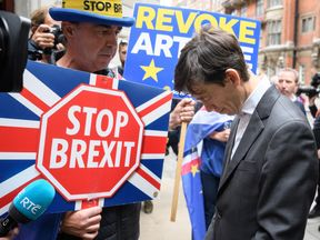 International Development Secretary and Conservative Party leadership candidate Rory Stewart (R) is interviewed by anti-Brexit protester Steve Bray after leaving Millbank studios on June 19, 2019 in London, England