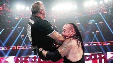 The Undertaker chokeslams Shane McMahon!