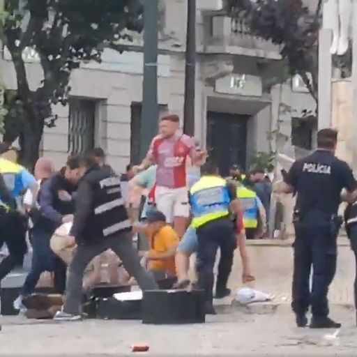 England fans throw bottles at police during clashes in Portugal
