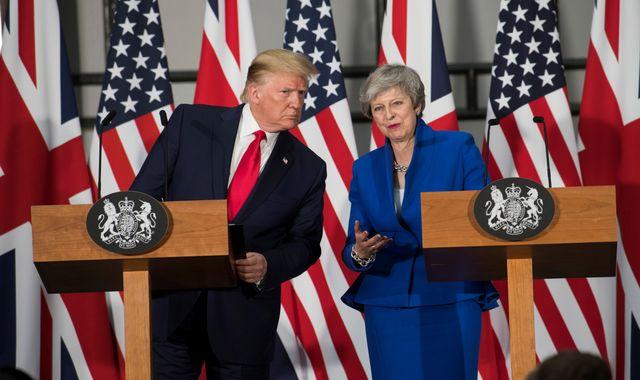 Theresa May calls Donald Trump 'go back' tweet 'completely unacceptable'