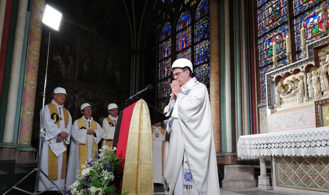 Priests wear hard hats at first Notre Dame mass since devastating fire