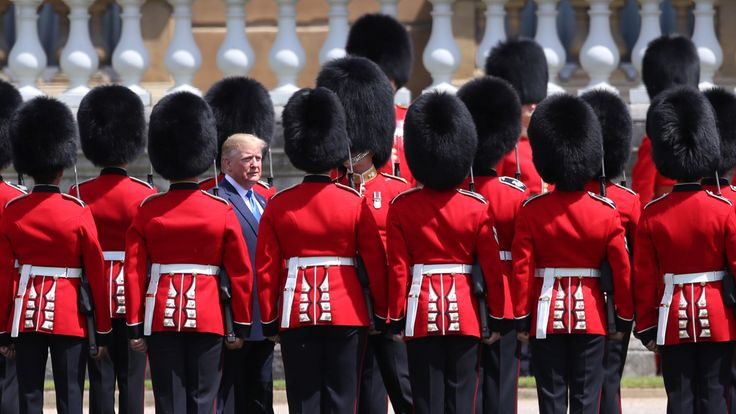 US President Donald Trump inspects an honour guard at Buckingham Palace