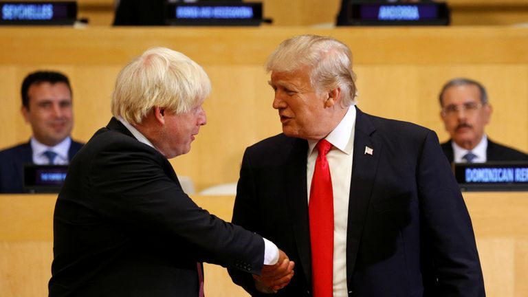 U.S. President Donald Trump shakes hands with British Foreign Secretary Boris Johnson (L) as they take part in a session on reforming the United Nations at U.N. Headquarters in New York, U.S., September 18, 2017. REUTERS/Kevin Lamarque