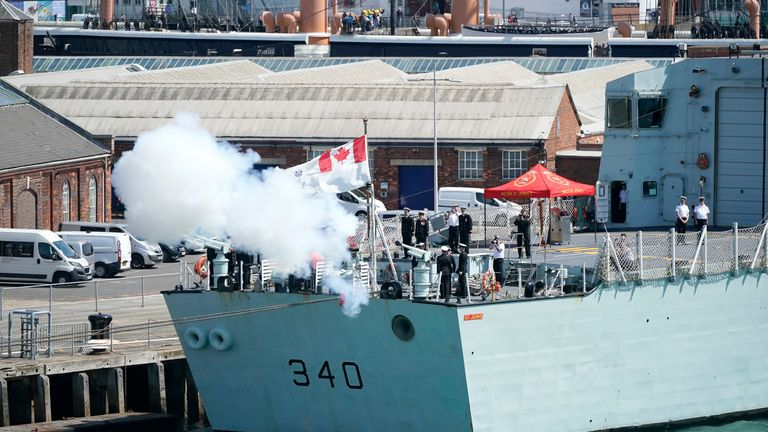 PORTSMOUTH, ENGLAND - JUNE 03: A Canadian war ship fires a gun salute a Brittany ferry transporting D-Day Veterans and their families to Caen and the Normandy beaches leaves Portsmouth on June 03, 2019 in Portsmouth, England.  Thursday 6th June is the 75th anniversary of the D-Day landings which saw 156,000 troops from the allied countries including the United Kingdom and the United States join forces to launch an audacious attack on the beaches of Normandy, these assaults are credited with the eventual defeat of Nazi Germany. A series of events commemorating the 75th anniversary are planned for the week with many heads of state travelling to the famous beaches to pay their respects to those who lost their lives. (Photo by Christopher Furlong/Getty Images)